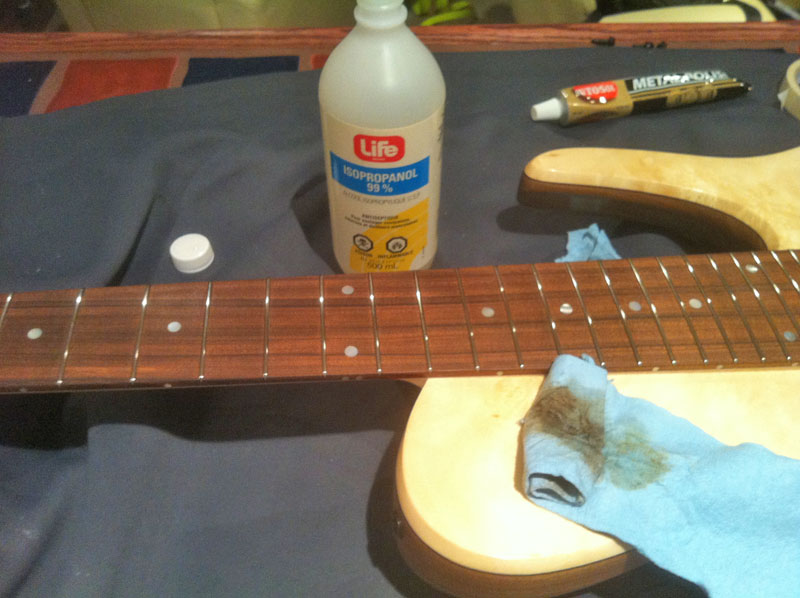 rubbing the fingerboard with alcohol